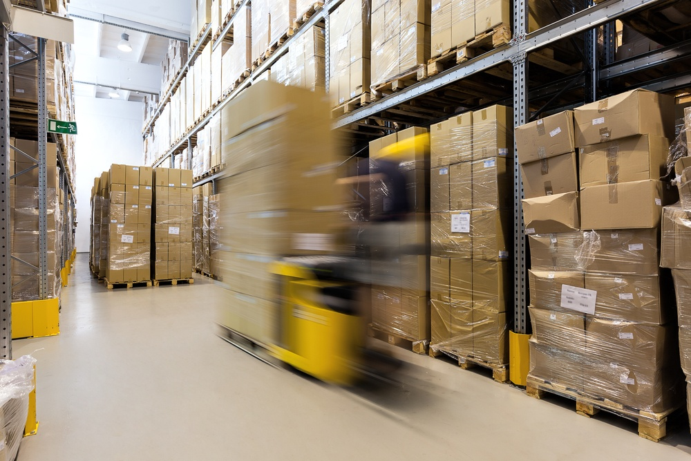 Fork lift operator preparing products for shipment.jpeg