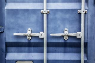 Blue metal door on a large shipping container.jpeg