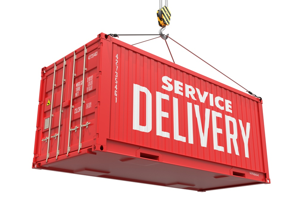 Service Delivery - Red Cargo Container hoisted by hook, Isolated on White Background..jpeg