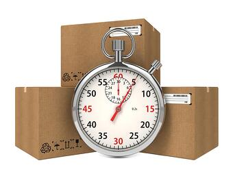 Stopwatch Over a Carton Boxes. Express Delivery Concept..jpeg